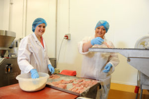 picture of students using the breading and battering line