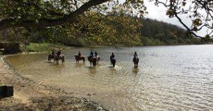 Students enjoy the short lived sunshine on the lake