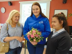 Anna Watson from Belfast with Taylor Dowell from Toomebridge, Co Antrim being welcomed to the Open Day at Greenmount Campus by level 2 floristry student Natalie Straney.