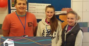 Dillon Taylor, Alex Orr and Abigail Cuddy on work placement in Dunbia