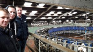 Steven Hamilton (Rathfriland), Gareth Finch (Armagh) and Adam Clyde (Ballymoney) with a bird's eye view over Kevin Forsyth's rotary parlour in Scotland