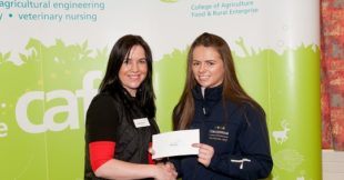 Emma Nagle receives a €1000 bursary from Regina Byrne from the ITBA