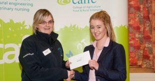 Megan Norton, Greenisland, Co.Antrim, receives a £1,000 bursary from Stacey Moss of Blue Frog.