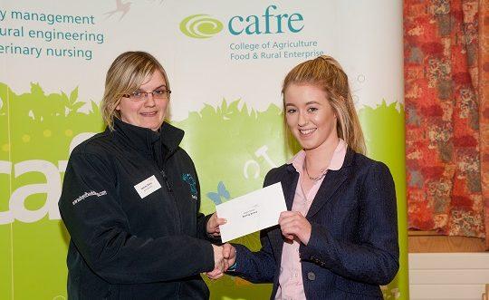 Megan Norton, Greenisland, Co.Antrim, receives a £1,000 bursary from Stacey Moss of Blue Frog.
