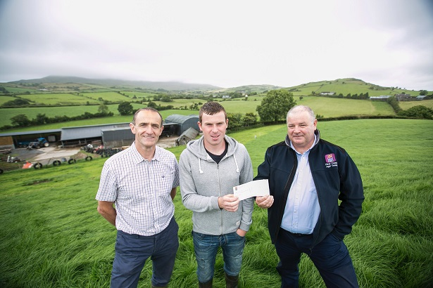 Kevin Henry from CAFRE (left) and Eoin Donnelly, Specialist Agri-Advisor at First Trust Bank (right) are pictured presenting young farmer Joe Milligan with a cheque for €1,000. Joe has been named runner-up in the AIB / Teagasc All-Ireland 'Best Farm Business Plan' competition and is the first farmer from Northern Ireland to win a top award in the final.