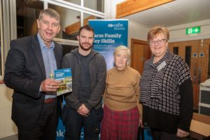 Two attendees and two speakers at a seminar held at Greenmount Campus