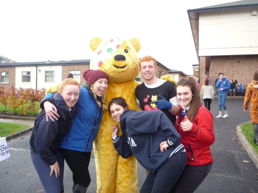 Group of students with Children in Need mascot, Pugsy the bear.