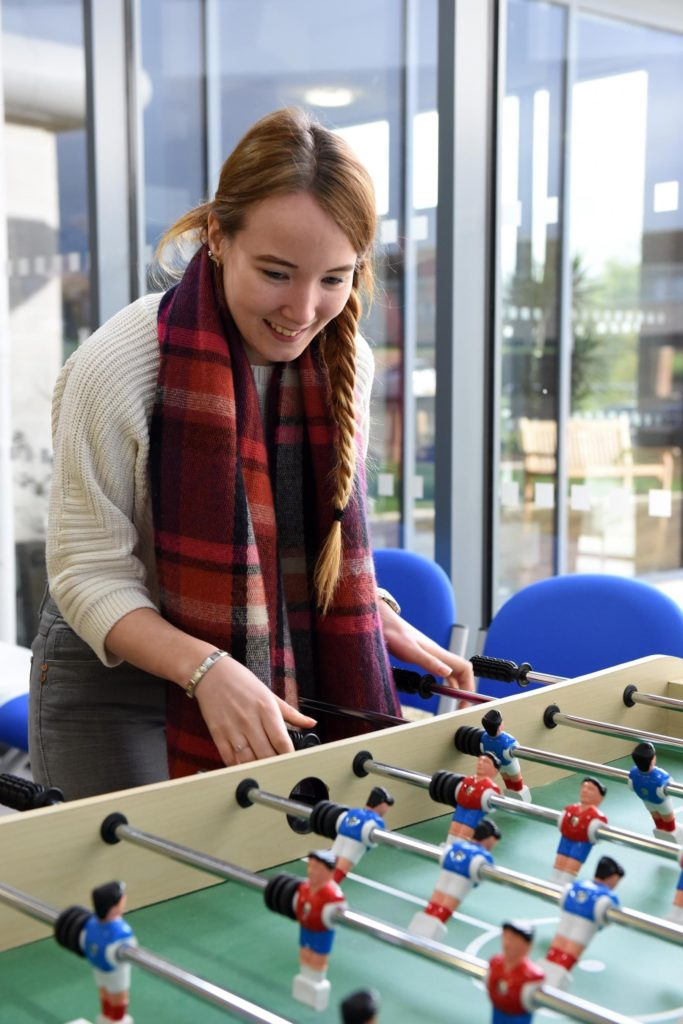student playing Table football