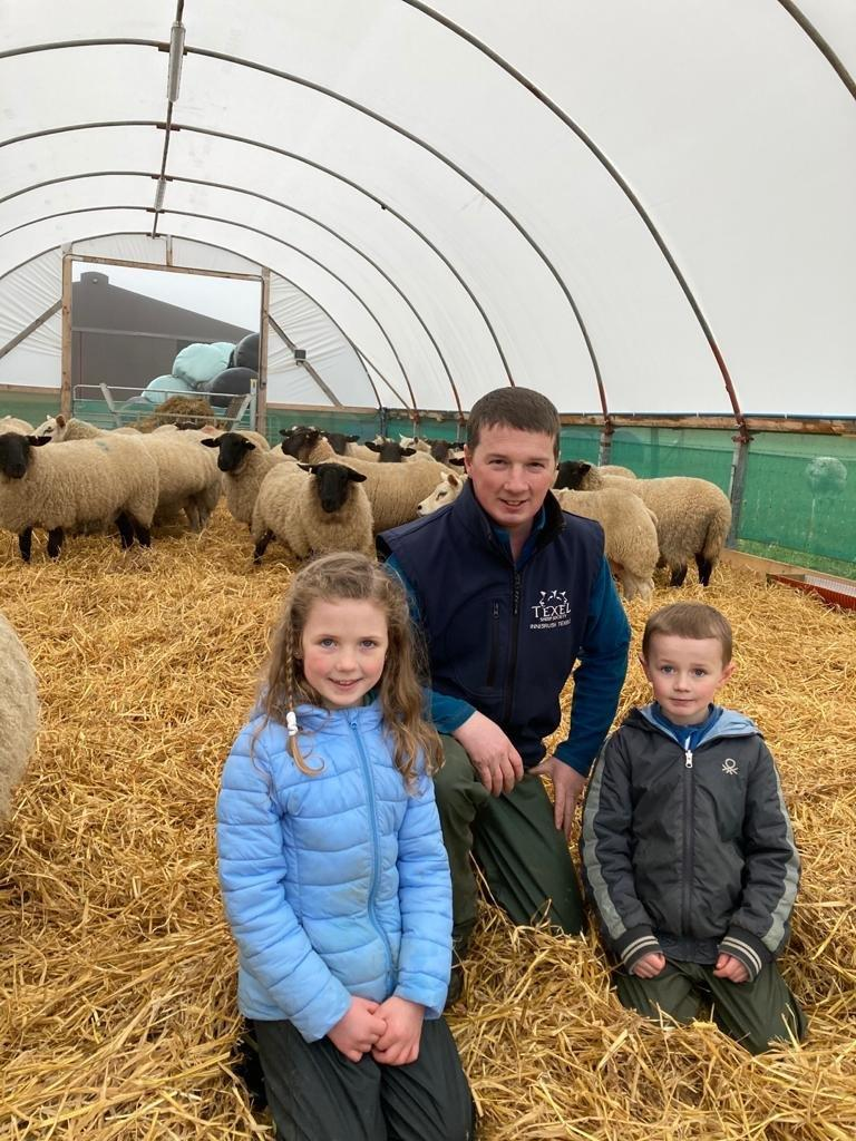 Philip Whyte, with daughter Ellie (aged 8) and son Jack (aged 6), showing off their polytunnel, outside Portglenone